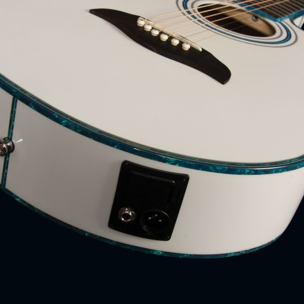angled view of body of white Oscar Schmidt acoustic guitar